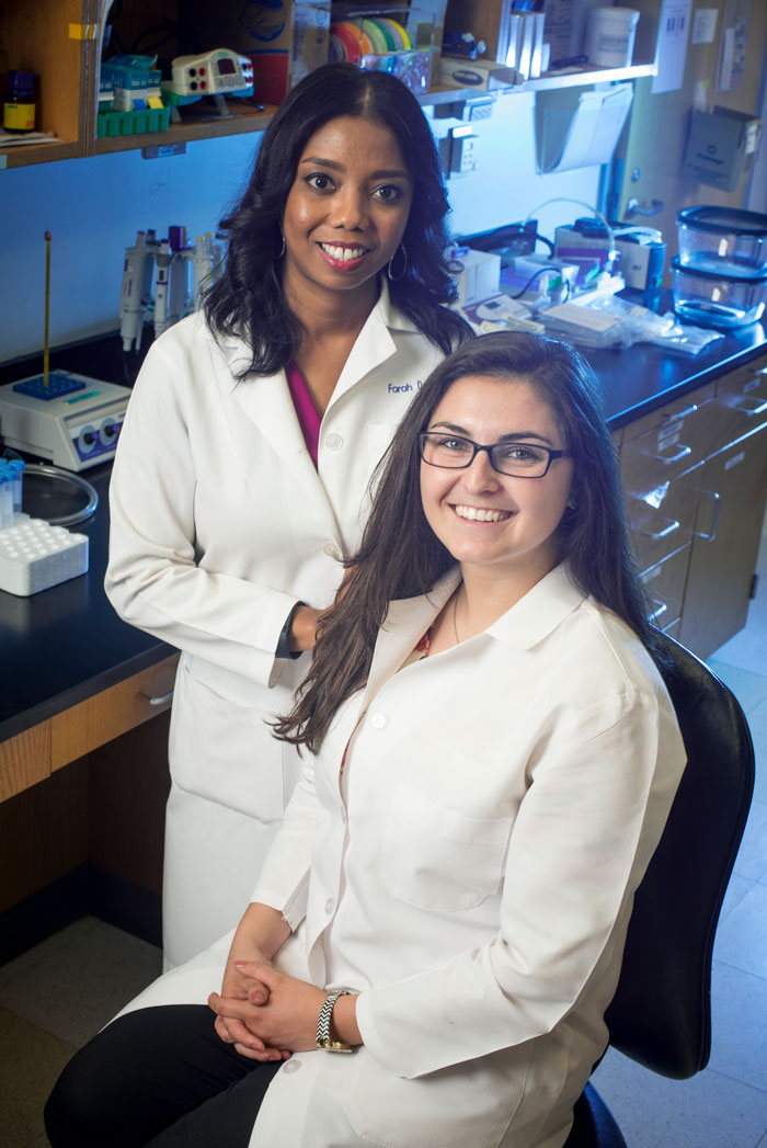 Photo of Farah Lubin and Rylie Hightower in lab