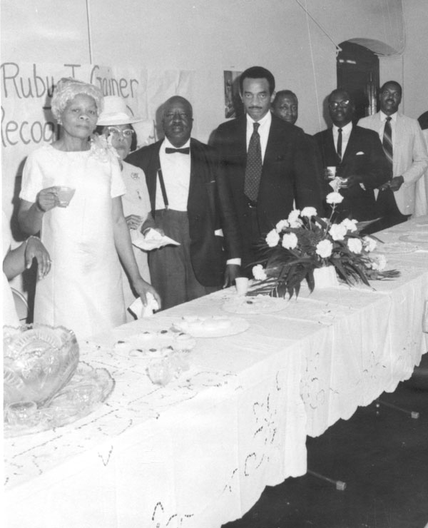 Photo of Ruby Jackson Gainer with her brother, Emory O. Jackson, at a celebration.