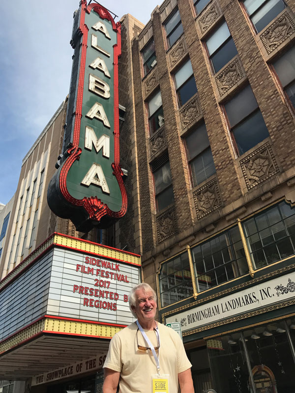 Photo of George Hardy in front of Birmingham's Alabama Theatre