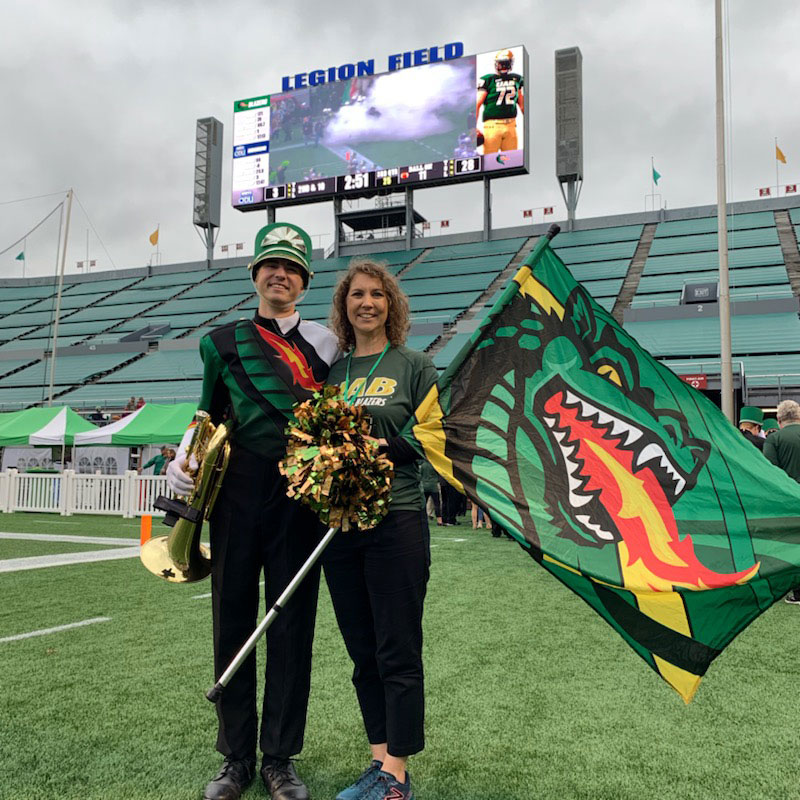 Photo of current band member Gabriel Clayton with his mother, Connie Clayton, at Legion Field