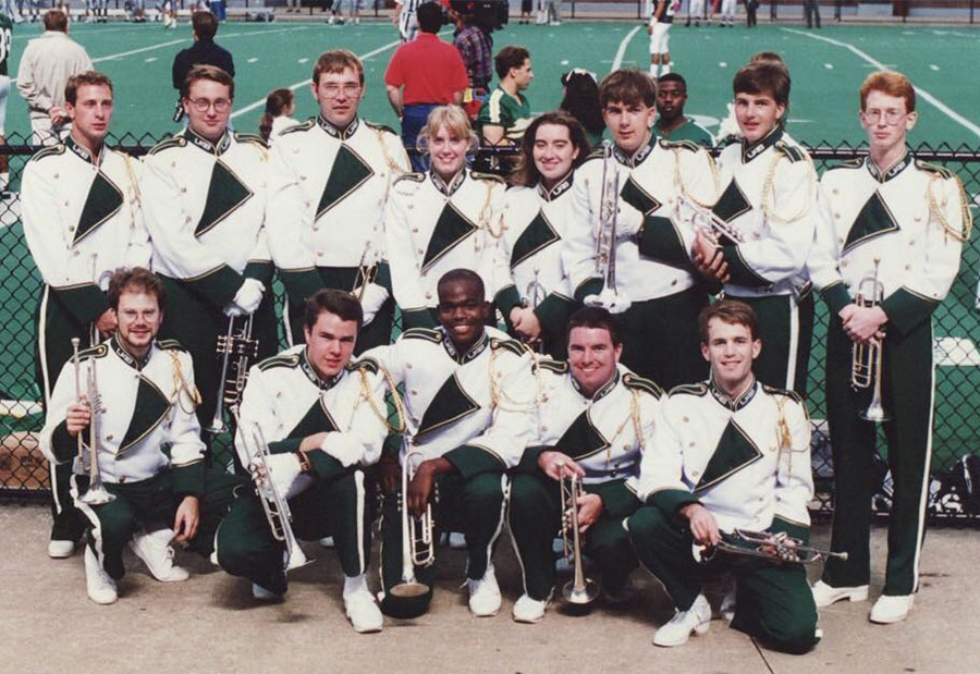 Photo of Jeremy McFall and other early band members in uniform at Legion Field in 1994