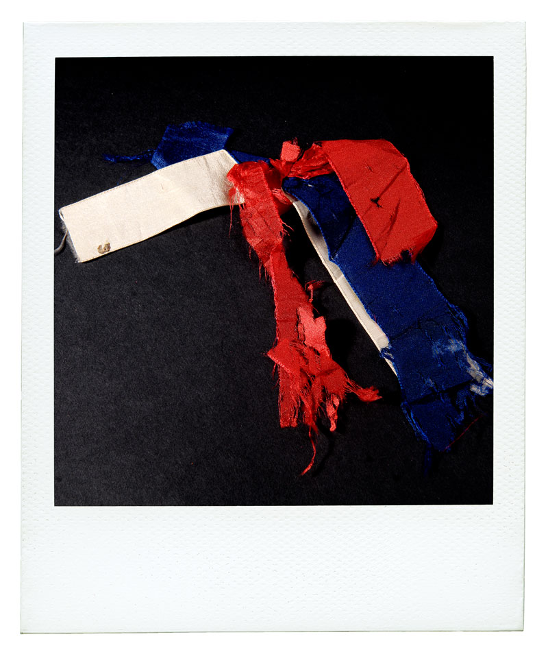 Photo of ragged red, white, and blue ribbon