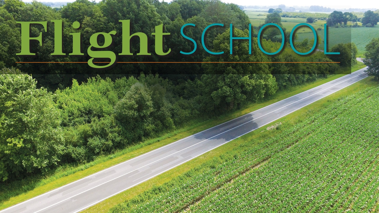 Drone photo of farmland with title: Flight School