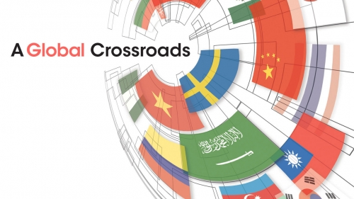 Illustration showing globe of international flags; headline: A Global Crossroads