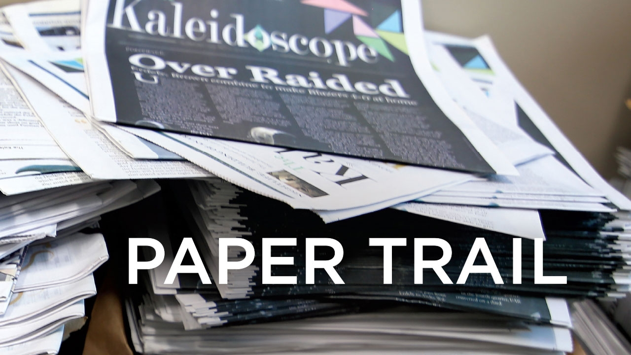 Photo of stacks of Kaleidoscope newspapers; headline: Paper Trail