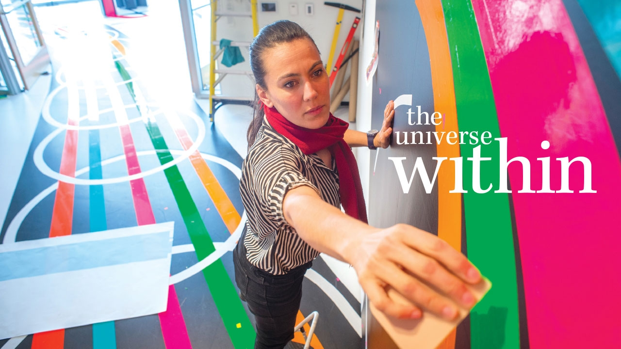 Photo of artist Jessica Angel working on her installation; headline: The Universe Within