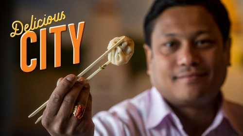 Photo of Chef Abhi Sainju holding one of his Nepalese dumplings; title: Delicious City