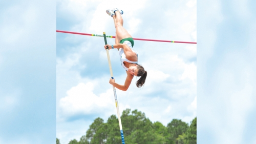 Photo of student Neal Tisher pole vaulting