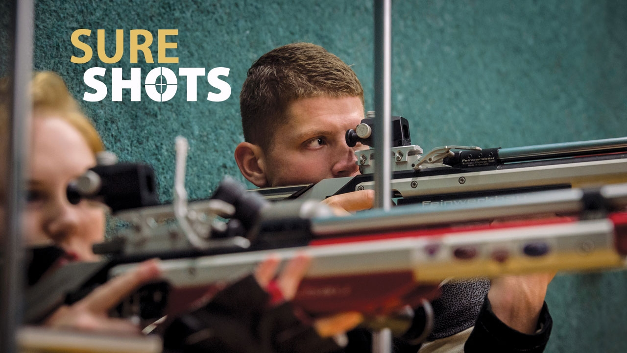 Photo of UAB rifle athlete taking aim at a target; headline: Sure Shots