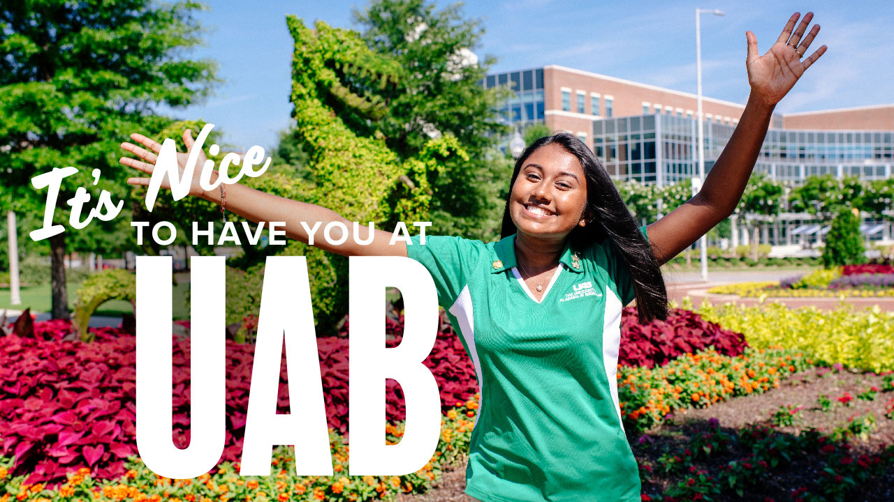 Photo of student volunteer raising arms in welcome; headline: It's Nice to Have You at UAB