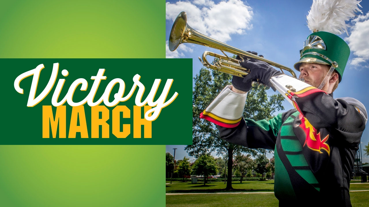 Photo of band member in new uniform playing trumpet; headline: Victory March