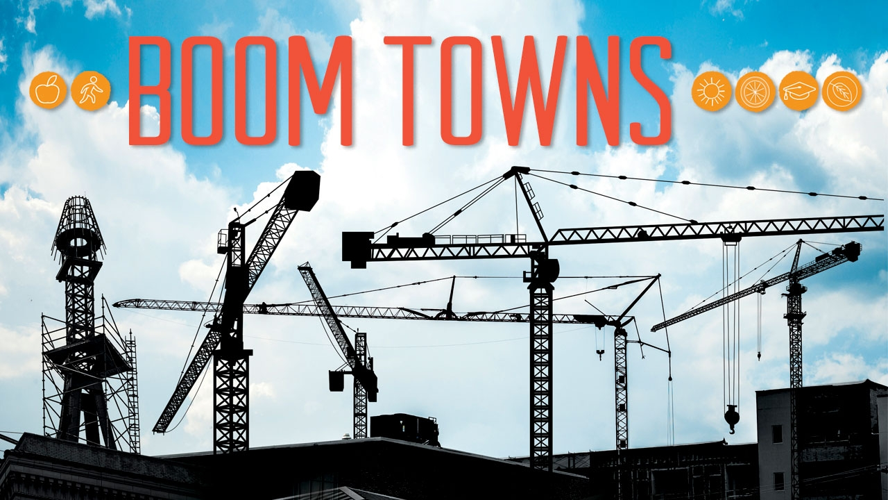 Illustration of cranes above city buildings; title: Boom Towns