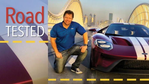 Photo of Trevor Hale on Dubai test track with Ford car; title: Road Tested