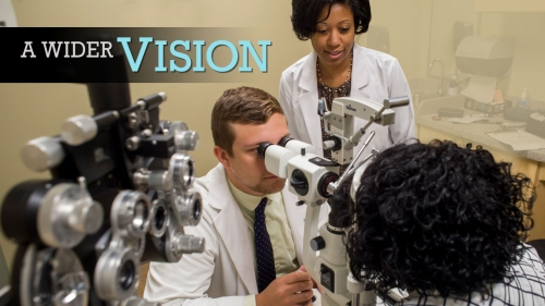 Photo of optometry student and faculty examining patient